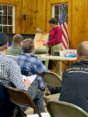 Greg Rogers, a visiting commercial beekeeper, discussing brood enhancement.